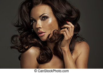 Natural beauty of the brunette lady