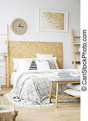 Natural bedroom with gold painting