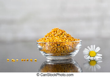 natural bee pollen  - cup of bee pollen, ambrosia on table