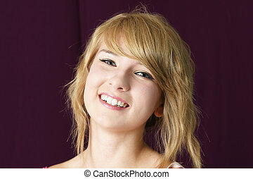 Natural blond girl smiling