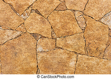 Natural brown stone wall background. Fuerteventura