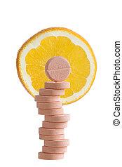Natural c vitamin and orange slice in background