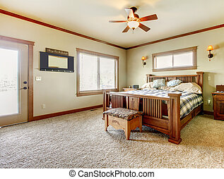 Natural cabin farm house bedroom with beige carpet and green...