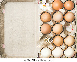 Natural colored eggs in box for Easter, copy space