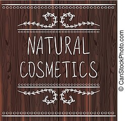 NATURAL COSMETICS handwritten letters on brown wood background