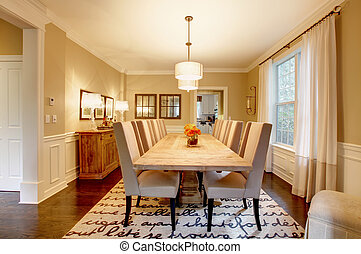 Natural design home dining room with large wood table. -...
