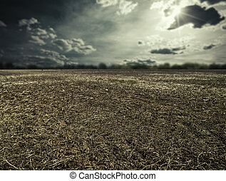 natural disaster. abstract landscape with dry land under mood skies