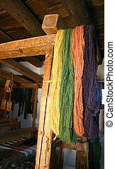Natural Dyed Yarn - Natural-dyed yarn hanging from antique...