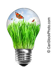 Natural energy concept. Light bulb with summer meadow and...