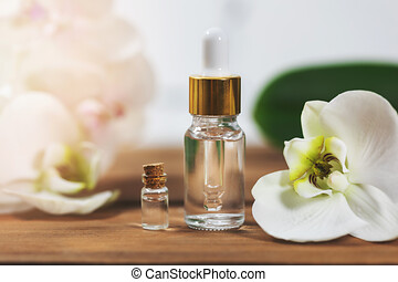 natural flower essential oil bottles with orchid blossom
