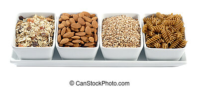 Four White Contemporary Ceramic Bowls Filled With Nuts And Grains