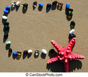 Natural frame on sandy beach with starfish