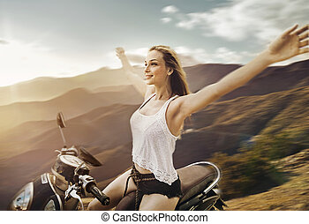 Natural, free woman riding a scooter