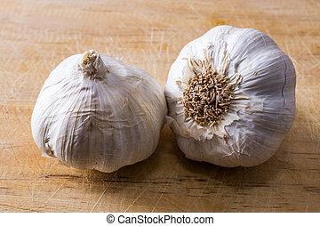 natural garlic on wooden background