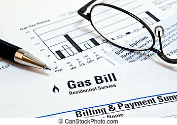 Natural gas heating bill with glasses and pen