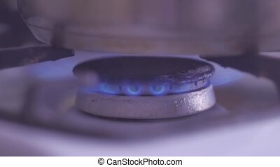 natural gas power supply gas stove. Burning gas the burner...