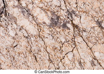 Natural granite stone with a unique pattern of inclusions of quartz veins