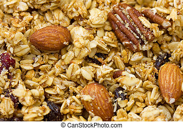 Close-up of natural granola with fruits and nuts.