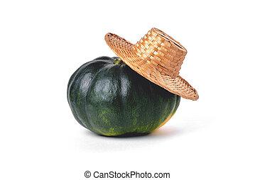 Natural green pumpkin, straw village hat, on a white background