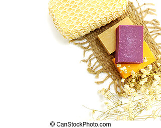 natural handmade herbal soap spa with bath sponge on whit ...