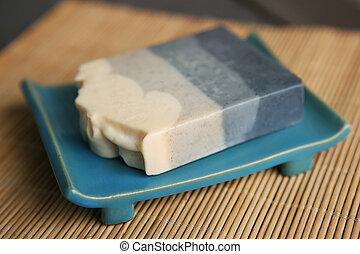 Bar of soap in soapbox.