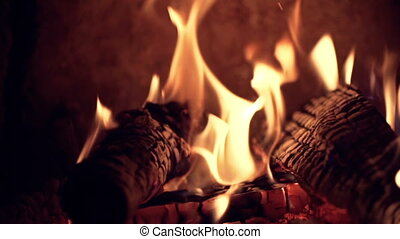 Natural Heat - Close up of logs burning in high definition