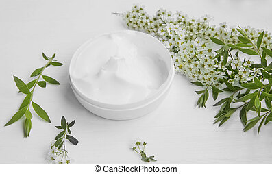 Natural herbal skin cream with white flowers, organic cosmetic skincare and spa still life
