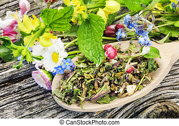 Natural herbal tea on wooden spoon