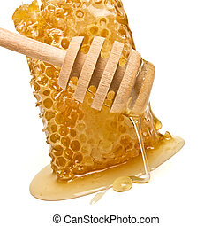 Natural Honeycomb - Natural Honey dripping from wooden...
