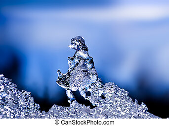 natural ice sculpture with a blue sky with clouds in the ...