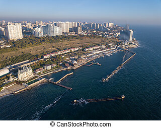 Natural landscape with costline of city Odesa, Ukraine. Seascape with sandy beach and blue water. Aerial view from drone.