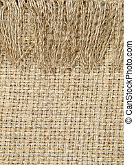 Natural linen texture pattern with fringe.Background.