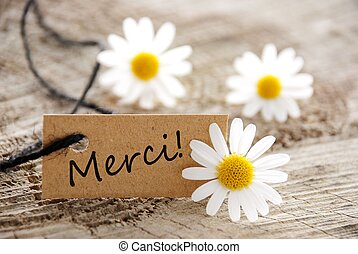 A Natural Looking Label with the French Word Merci Which Means Thanks