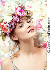 natural make-up - Beautiful romantic young woman in a wreath...