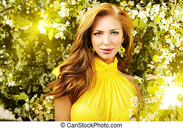 natural make-up - Romantic young woman in the spring garden...