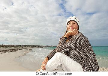 Natural mature woman ocean background