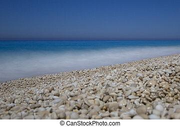 Milos gravel beach, deep blue sea and sky, lefkada, lefkas, greece