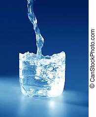 Natural mineral blue water falling down making a plastic...