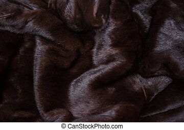 Natural mink fur brown. Texture, background. Natural brown mink coat close up, short nap