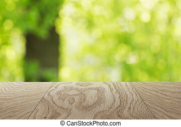 natural oak table template with blurred oak tree on background, place your product