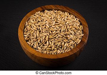 natural oat grains background, closeup