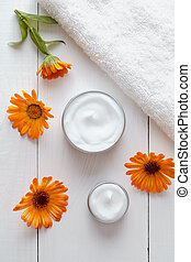 Natural organic herbal cosmetic cream with calendula flowers