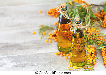 Natural organic sea-buckthorn berry and sea buckthorn oil in glass vintage bottle