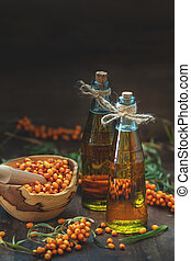Natural, organic sea-buckthorn berry in bowl and sea...