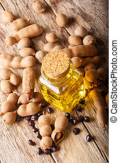 Natural organic tamarind oil in a glass jar close-up....