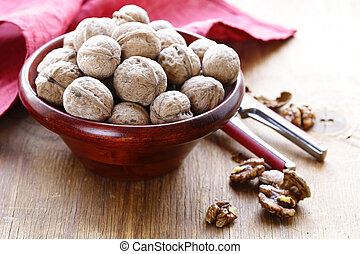 natural organic walnuts in a wooden bowl
