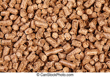 natural pellet - close up image of natural wood pellet...