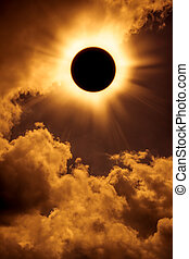 Natural phenomenon. Solar eclipse space with cloud on gold sky background. Outdoors.