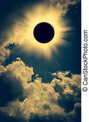 Natural phenomenon. Solar eclipse space with cloud on gold sky background. Outdoors. Vintage tone effect.