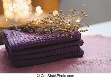 Natural pure linen towels, napkins or tablecloth. Colourful linen cotton fabrics on fabric background. Food photo props